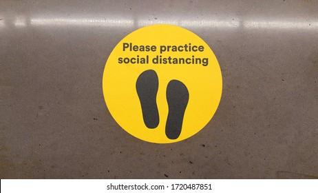 Please Practice Social Distancing Footprint Floor Decal