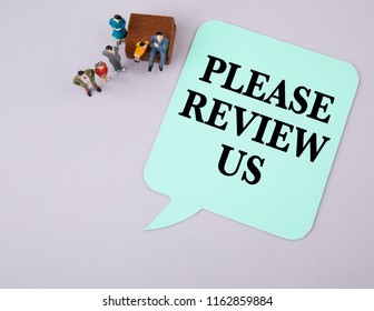 Please Review Us. Social media and business concept. Paper speech bubble