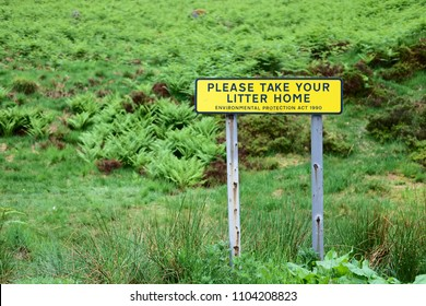 Please take litter home sign rubbish garbage waste bin pollution environment save outdoor park highlands wild fern woodlands green scene beautiful recycle Scotland uk
