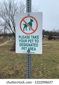 Please Take Your Pet to Designated Pet Area sign at highway rest area