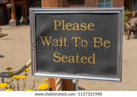 Please Wait Be Seated Sign Stock Photo Edit Now 1137321980