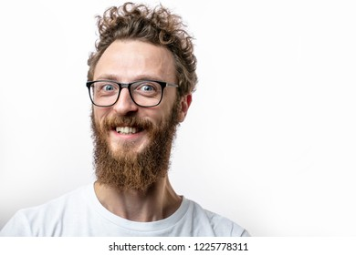 Pleased kindly looking guy wearing spaectacles, smiling at camera, happy to see his best friend, isolated over white background with copyspace. People, positive emotions and facial expressions concept
