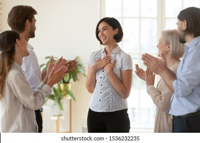 Pleased proud asian young businesswoman get multiethnic team appreciation support applause, happy diverse business people group applauding praising korean female worker, employee recognition concept