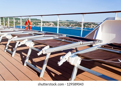 Pleasing and relaxing view from the deck on a cruise ship for summer vacation, with chairs. This is good to advertise vacation and holidays on cruises.