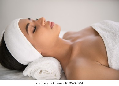 Pleasurable rest. Pleasant attractive woman being in the spa along while trying to relax