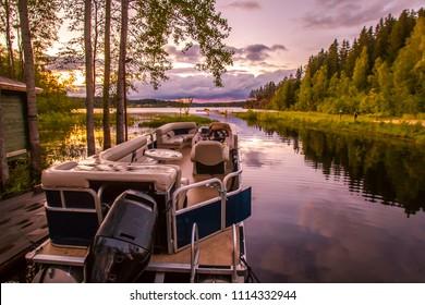 Pleasure boat. Berth with motorboat. Walks on the lake.
