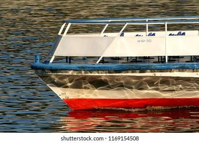 Pleasure boat sails on the river