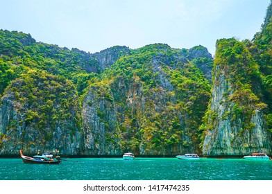 The pleasure boat trip around Phi Phi Archipelago is the best way to explore the most beautiful locations of the islands, such as Pileh Bay of Phi Phi Leh Island, Krabi, Thailand