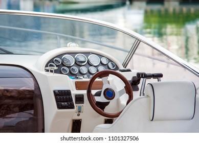 Pleasure boat. White tone. Steering wheel
