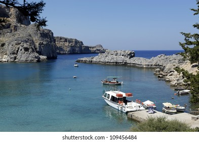 Pleasure boats in the bay of St Paul, lindos, Rhodes, Greece, Europe