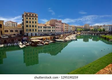 Pleasure boats moored along the quai of the Fortezza Nuova, Livorno, Italy
