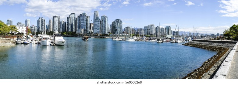 Pleasure boats moored in a False Creek marina and densely populated Yaletown in the distance. Vancouver British Columbia.