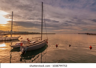 Pleasure boats moored in harbor at sunset. Trieste Italy