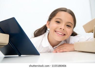 Pleasure concept. Little girl smile with pleasure of reading book. Cute child study with pleasure. A simple pleasure.
