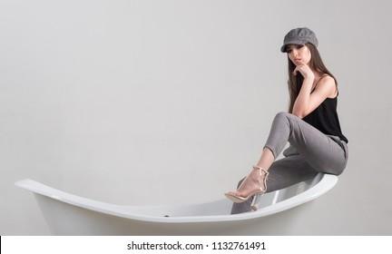 Pleasure concept. Woman take pleasure in bathroom. Pleasure and wellbeing. Find pleasure in daily routine, copy space.