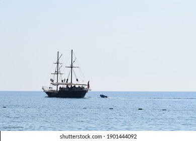 Pleasure craft sailing ship decorated as a pirate, on a background of blue sky and sea. The concept of summer holidays, sports, tourism. Pirate cruise sail ship, Tekirova, Turkey