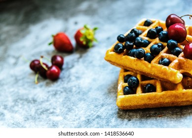 The pleasure of having breakfast on a Sunday morning a luxurious waffle with antioxidant red fruits full of vitamins for a healthy and full life.