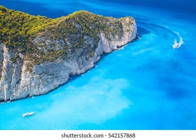 Pleasure motor boats, Navagio Bay, Greece. The most famous nature landmark of Greek island Zakynthos in the Ionian Sea