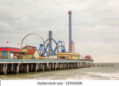 The Pleasure Pier in Galveston, Texas / Pleasure Pier / The Pleasure Pier attracts visitors to Galveston Island, Texas