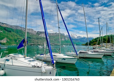 Pleasure yachts in sunny day at Annecy lake surrounded by mountains, ANNECY, ANNECY LAKE, FRANCE - MAY 09, 2013