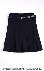 Pleated black uniform skirt isolated. Girls beautiful belted black skirt on white background. Classic pleated skirt with a belt.
