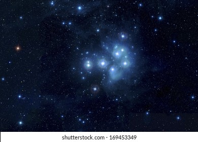 The Pleiades, or Seven Sisters, is an open star cluster containing middle-aged hot B-type stars located in the constellation of Taurus. Elements of this image furnished by NASA.