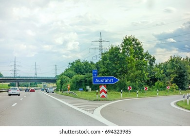Pleideslheim, Germany - June 28, 2017: Highway exit (Ausfahrt) german motorway Autobahn A81 near town Pleidelsheim, direction to Stuttgart / Ludwigsburg city