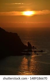 Plemont Pt., Jersey, U.K. Rugged coast Summer sunset.