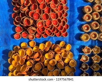 Plenty of assorted traditional Indian earthen lamps or diyas selling on the street shop during festival of Diwali. Shot from above.