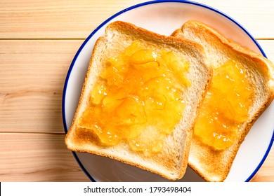 the plenty orange marmalade on the toast.