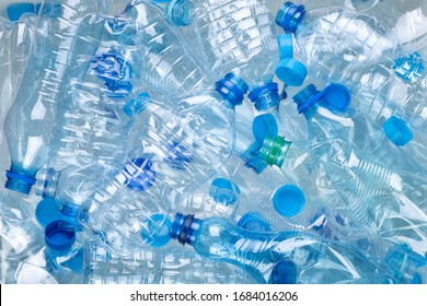 Plenty of plastic bottles on white background top view - Shutterstock ID 1684016206