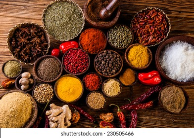 Plenty of traditional Asian spices in wooden bowls