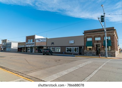 PLENTYWOOD, MONTANA - DECEMBER 2, 2017:  Looking down Main Street of the quiet small rural town of Plentywood, Montana, USA, on an early December afternoon.
