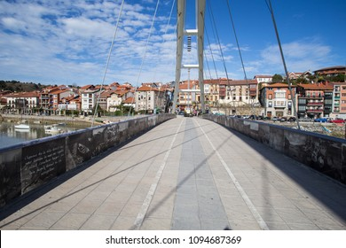 PLENTZIA, SPAIN - FEBRUARY 15, 2018: Cable-stayed pedestrian bridge over the Butron River.