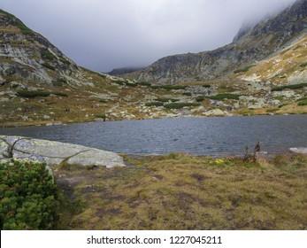 Pleso nad Skokom, beautiful mountain lake in Mlynicka Dolina Valley with hiking peoples on footpath High Tatras mountain, Vysoke Tatry , Slovakia
