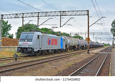 PLESZEW, POLAND - JUNE 23, 2016 - Lotos Kolej freight train transporting petrol at Pleszew station