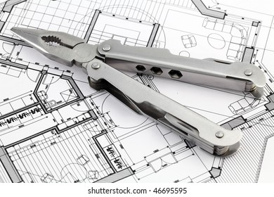 pliers and architectural plan of the modern house