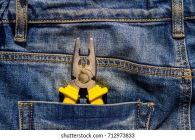 Pliers to repair in pocket of blue jeans