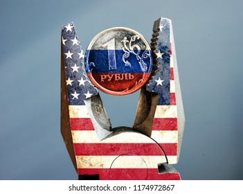 Pliers with USA flag squeezed the ruble with Russian flag. Sanction.
