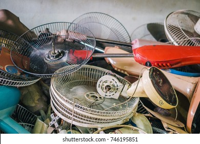 Plies of Broken Electric Fans in Electronic Waste Disposal or Recycling Dump Site concept for electronic consumerism, modernization, digital age, urbanization, environmental crisis, and toxic-waste