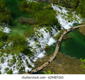 Plitvice, Croatia - Lakes with turquoise water connected by a waterfall in Plitvice National Park. The park is UNESCO World Heritage Site