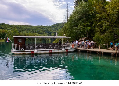 PLITVICE LAKE NATIONAL PARK, CROATIA - AUG 19, 2014: Unidentified people    on board of a tourist boat in the Plitvice Lakes National Park, which is a UNESCO World Heritage site