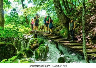 PLITVICE LAKES, CROATIA - 29 JUNE 2017. Tourists in the Plitvice Lakes National Park.