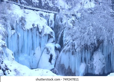 Plitvice lakes, National park in Croatia, winter landscape with frozen waterfalls