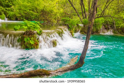 Plitvice Lakes National Park waterfall landscape with turquoise blue and green water in Croatia.