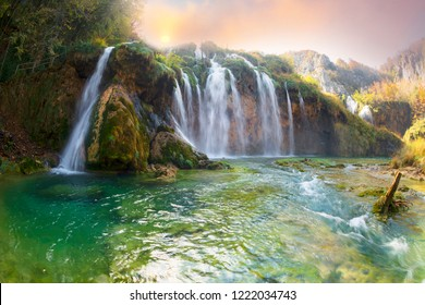 Plitvice Waterfalls in Croatia is one of the famous famous places in Europe, very beautiful. The jets of water on the background of autumn forests at sunrise are very picturesque