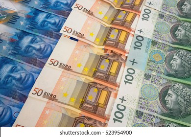 PLN EURO and CHF banknotes laying in a rows