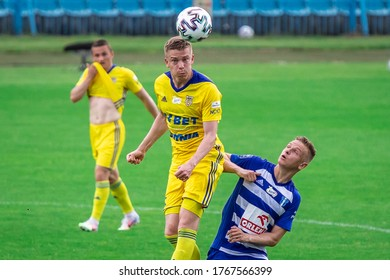 PLOCK, POLAND - 20 JUNE, 2020: Michal Kopczynski of Arka Gdynia and Mateusz Szwoch of Wisla Plock are seen in action during the PKO Ekstraklasa match between Wisla Plock and Arka Gdynia.
