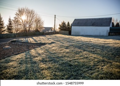 A plot of land with a lawn for the construction of a new house or territory for grazing farm animals in a frosty sunny morning