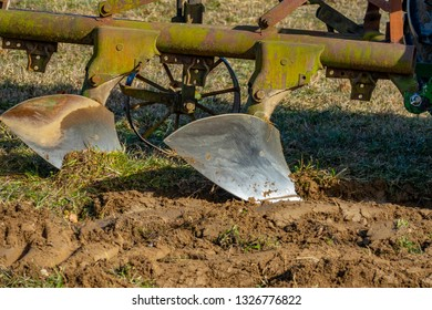 plough (plow) on a field close up